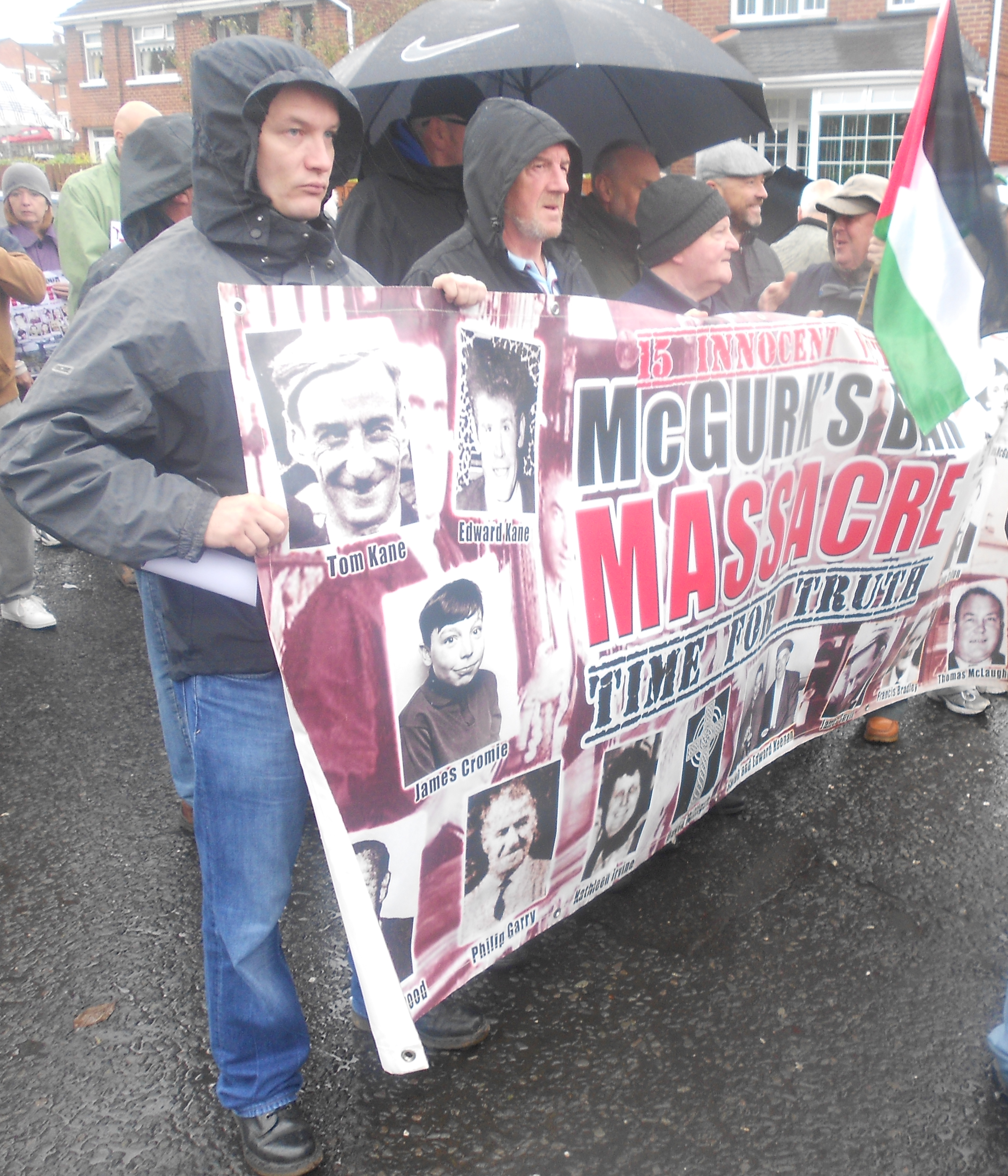 Ciarán MacAirt and other McGurk's Bar family campaigners